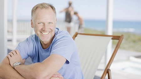Smiling older man at beach
