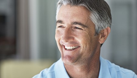 Older man with whole healthy smile